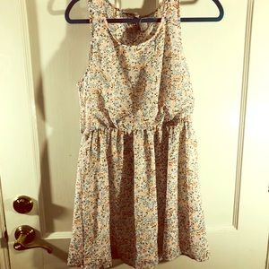 Floral mini dress with an open back